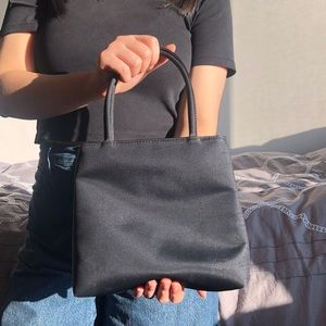 Structured simple black hand bag.